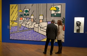 Robert Kirschener and Erin Clancey have a conversation while standing in front of wallpaper done by Lichtenstein. A new exhibition exploring the historical and cultural context of Roy Lichtenstein's life and work is on view at the Skirball Cultural Center. The exhibition sheds light on the social impact of Pop Art, especially as it developed here in Los Angeles. Los Angeles, CA. October 6, 2016. Photo by John McCoy, Los Angeles Daily News/SCNG